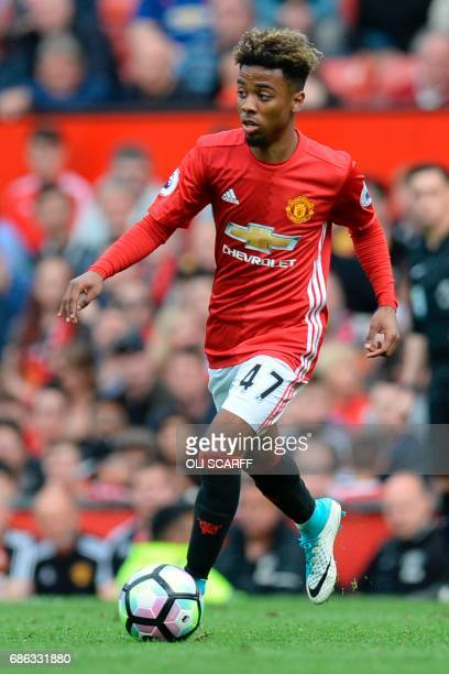 Manchester United's English midfielder Angel Gomes runs with the ball during the English Premier League football match between Manchester United and...