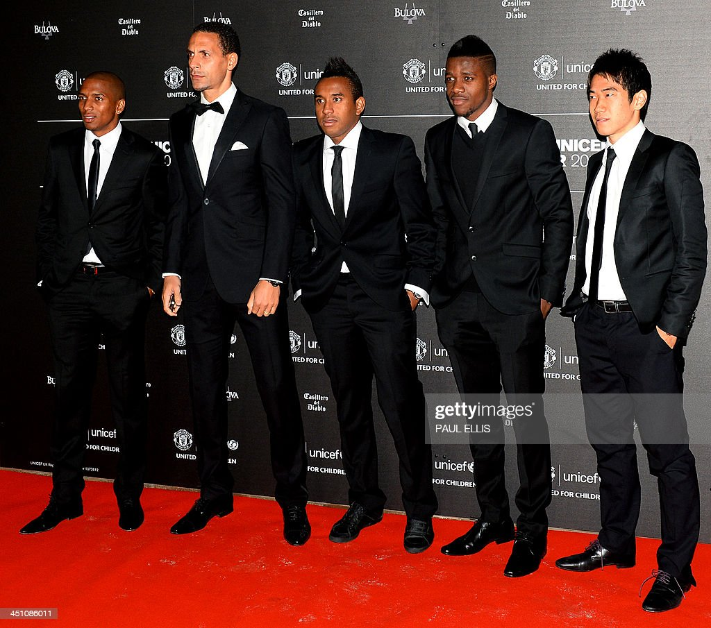 Manchester United's English midfielder Ashley Young, Manchester United's English defender Rio Ferdinand, Manchester United's Brazilian midfielder Anderson, Manchester United's Ivorian-born English striker Wilfried Zaha and Manchester United's Japanese midfielder Shinji Kagawa pose for photographs as they arrive for a gala dinner in aid of UNICEF at Old Trafford in Manchester on November 21, 2013.