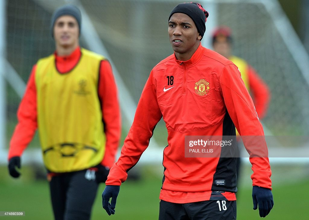 Manchester United's English midfielder Ashley Young (R) takes part in a training session at their Carrington complex in Manchester, north west England, on February 24, 2014 ahead of the UEFA Champions League football match between Olympiakos and Manchester United on February 25. AFP PHOTO / PAUL ELLIS