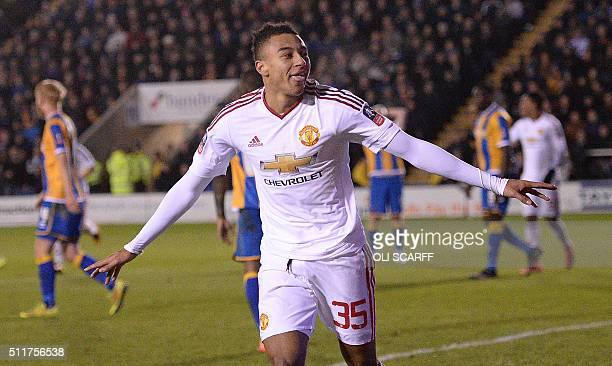 Manchester United's English midfielder Jesse Lingard celebrates scoring his team's third goal during the English FA Cup fifth round football match...