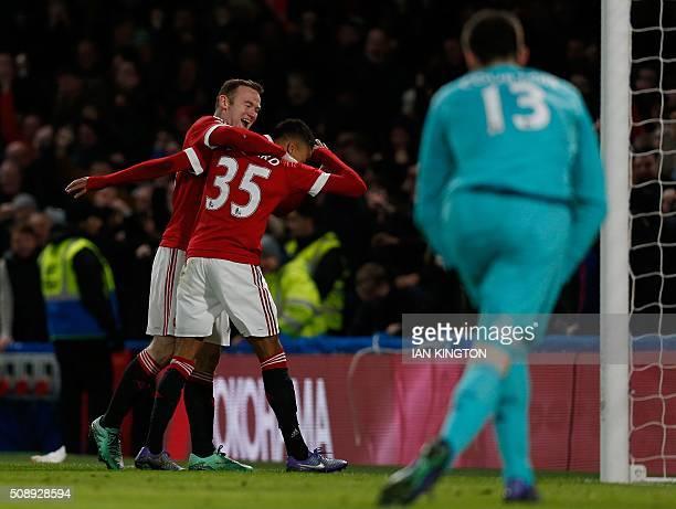 Manchester United's English midfielder Jesse Lingard celebrates with Manchester United's English striker Wayne Rooney after scoring during the...