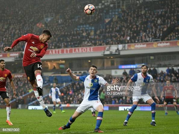 Manchester United's English midfielder Jesse Lingard heads the ball over the goal during the English FA Cup fifth round football match between...