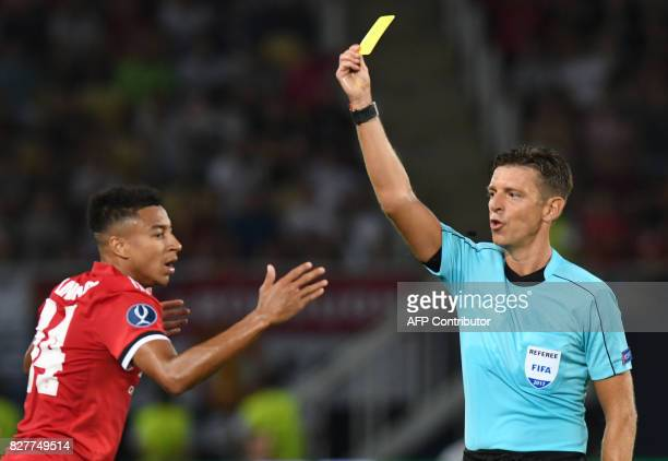 Manchester United's English midfielder Jesse Lingard is shown a yellow card by main referee Gianluca Rocchi during the UEFA Super Cup football match...