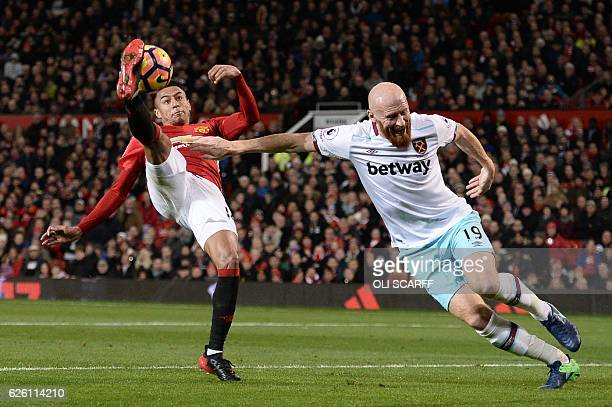Manchester United's English midfielder Jesse Lingard kicks the ball overhead as West Ham United's Welsh defender James Collins tries to defend during...