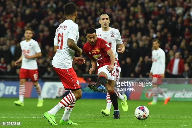 Manchester United's English midfielder Jesse Lingard scored their second goal during the English League Cup final football match between Manchester...