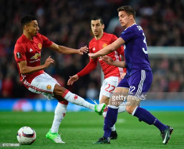 Manchester United's English midfielder Jesse Lingard takles Anderlecht's Belgian midfielder Leander Dendoncker during the UEFA Europa League...