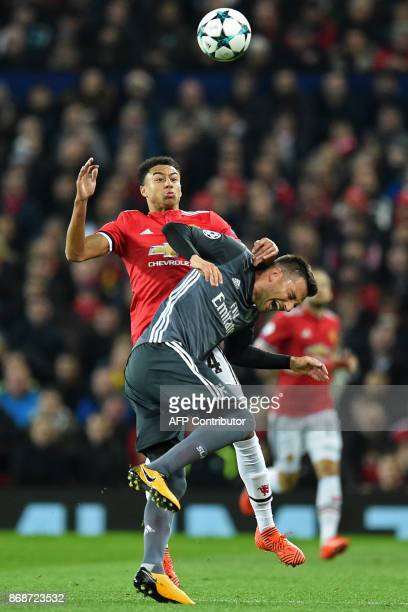 Manchester United's English midfielder Jesse Lingard vies with Benfica's Greek midfielder Andreas Samaris during the UEFA Champions League Group A...
