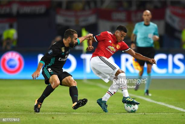 Manchester United's English midfielder Jesse Lingard vies with Real Madrid's Spanish defender Dani Carvajal during the UEFA Super Cup football match...