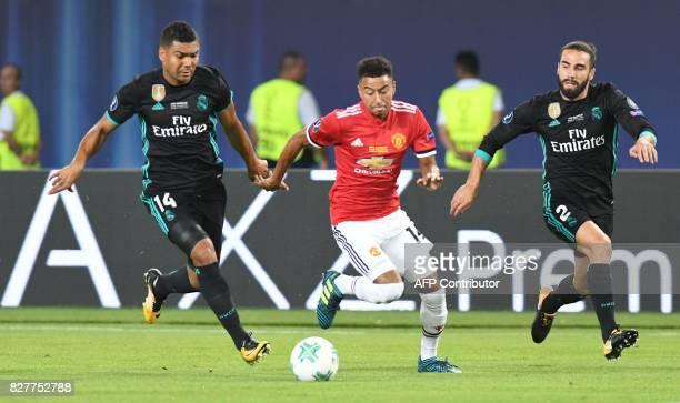 Manchester United's English midfielder Jesse Lingard vies with Real Madrid's Brazilian midfielder Casemiro and Real Madrid's Spanish defender Dani...