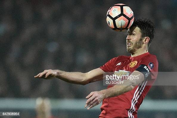 Manchester United's English midfielder Michael Carrick heads the ball during the English FA Cup fifth round football match between Blackburn Rovers...