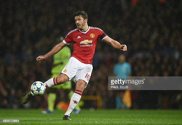 Manchester United's English midfielder Michael Carrick shoots toward goal during a UEFA Chamions league group stage football match between CSKA...