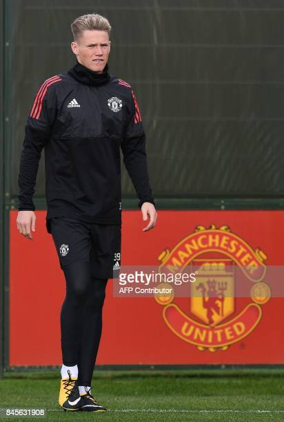 Manchester United's English midfielder Scott McTominay attends a team training session at the club's training complex near Carrington west of...