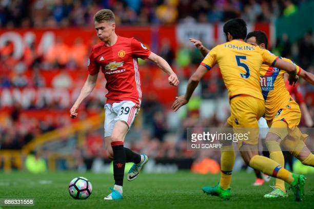 Manchester United's English midfielder Scott McTominay runs with the ball during the English Premier League football match between Manchester United...