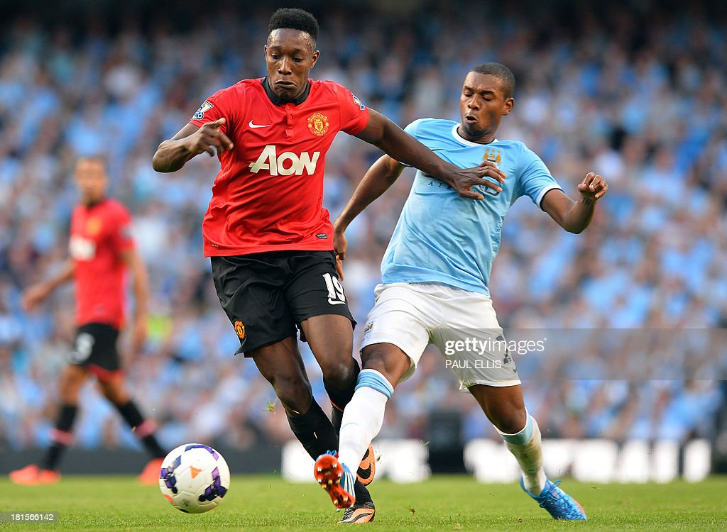 Manchester United's English striker Danny Welbeck (L) is tackled by Manchester City's Brazilian midfielder Fernandinho (R) during the English Premier League football match between Manchester City and Manchester United at the Etihad Stadium in Manchester, northwest England, on September 22, 2013. Manchester City won 4-1. AFP PHOTO / PAUL ELLIS USE. No use with unauthorized audio, video, data, fixture lists, club/league logos or live services. Online in-match use limited to 45 images, no video emulation. No use in betting, games or single club/league/player publications.