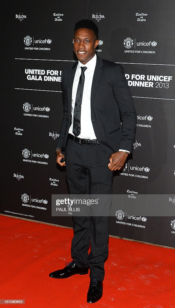 Manchester United's English striker Danny Welbeck poses for photographs as he arrives for a gala dinner in aid of UNICEF at Old Trafford in Manchester on November 21, 2013. AFP PHOTO/PAUL ELLIS