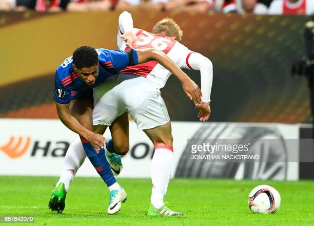 Manchester United's English striker Marcus Rashford and Ajax Dutch defender Matthijs de Ligt vie for the ball during the UEFA Europa League final...