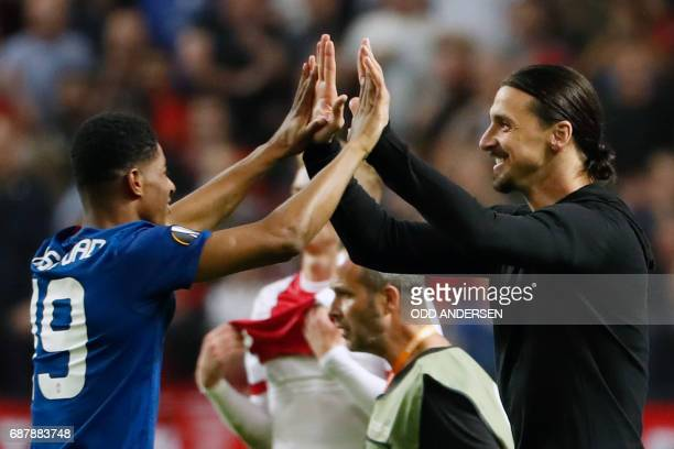 Manchester United's English striker Marcus Rashford and Manchester United's Swedish striker Zlatan Ibrahimovic celebrate after the UEFA Europa League...