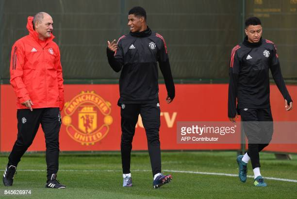 Manchester United's English striker Marcus Rashford and Manchester United's English midfielder Jesse Lingard attends a team training session at the...