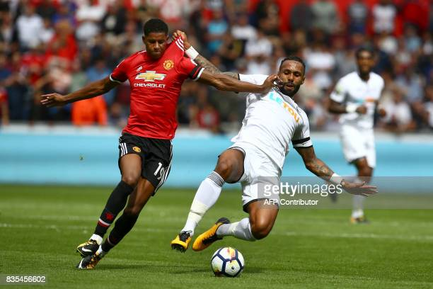 Manchester United's English striker Marcus Rashford and Swansea City's English defender Kyle Bartley vie during the English Premier League football...