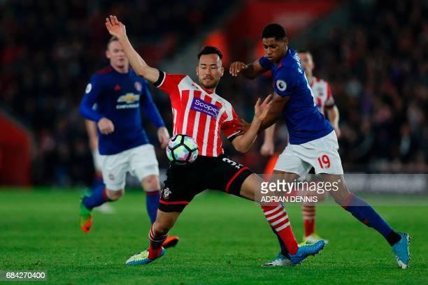 Manchester United's English striker Marcus Rashford battles with Southampton's Japanese defender Maya Yoshida during the English Premier League...