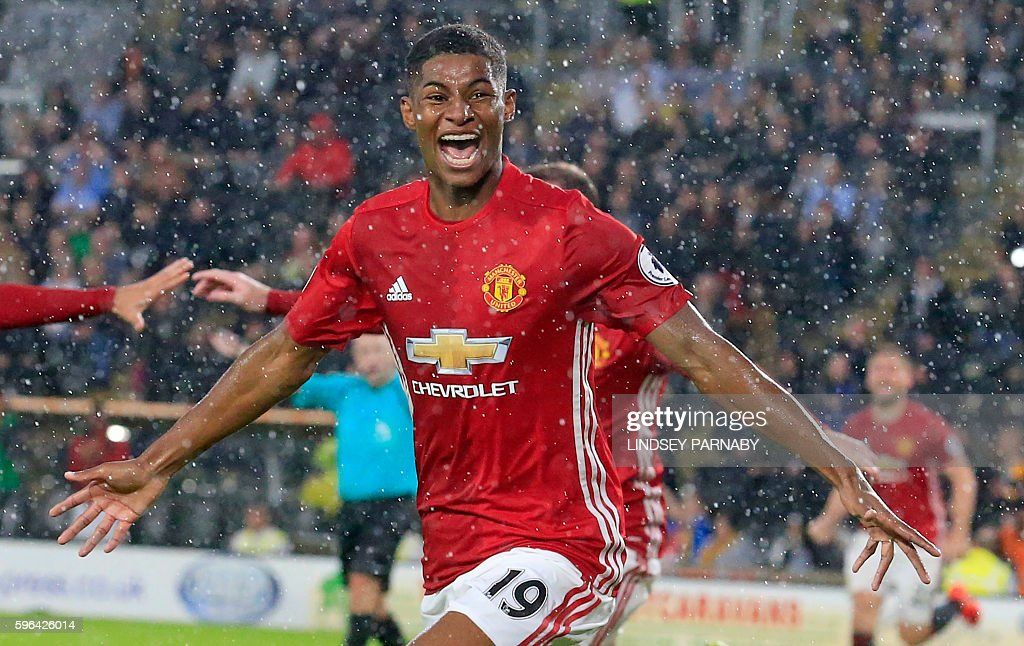 Manchester United's English striker Marcus Rashford celebrates after scoring their late winning goal during the English Premier League football match between Hull City and Manchester United at the KCOM Stadium in Kingston upon Hull, north east England on August 27, 2016. Manchester united won the game 1-0. / AFP / Lindsey PARNABY / RESTRICTED TO EDITORIAL USE. No use with unauthorized audio, video, data, fixture lists, club/league logos or 'live' services. Online in-match use limited to 75 images, no video emulation. No use in betting, games or single club/league/player publications. /