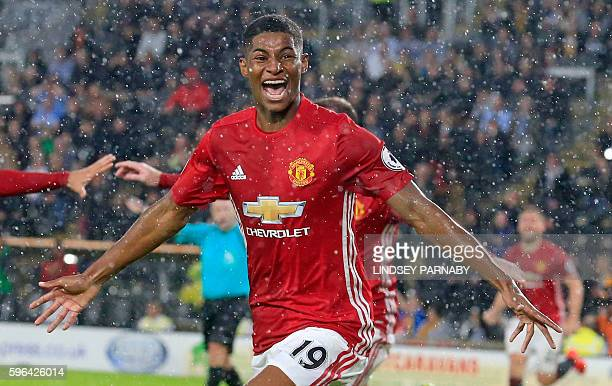 Manchester United's English striker Marcus Rashford celebrates after scoring their late winning goal during the English Premier League football match...