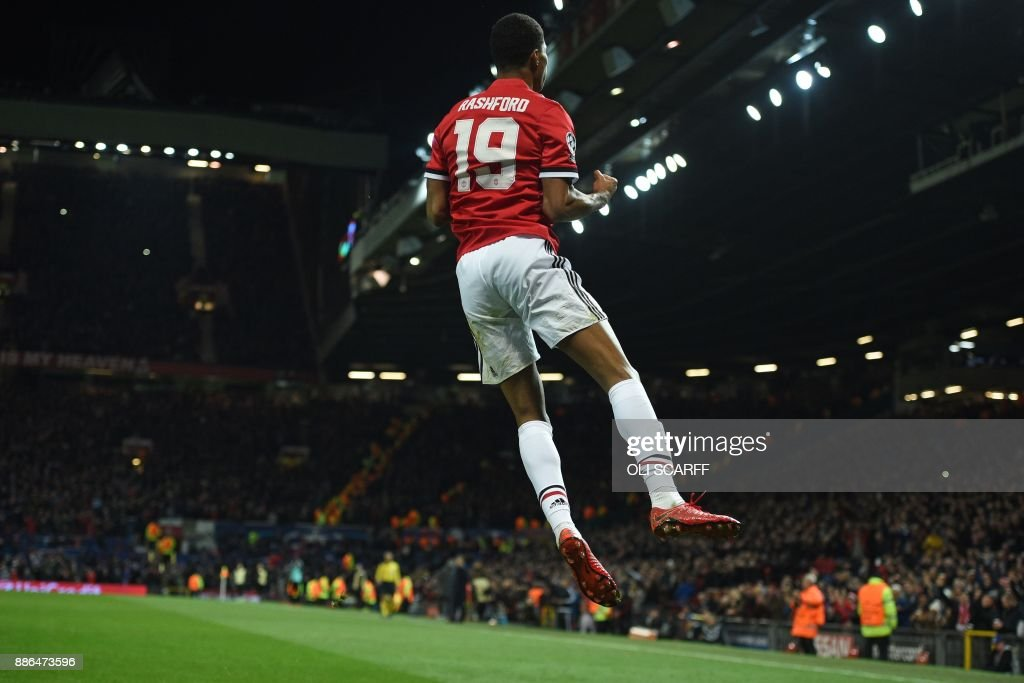 TOPSHOT - Manchester United's English striker Marcus Rashford celebrates after scoring their second goal during the UEFA Champions League Group A football match between Manchester United and CSKA Moscow at Old Trafford in Manchester, north west England on December 5, 2017. / AFP PHOTO / Oli SCARFF