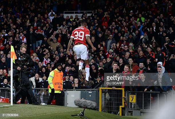 Manchester United's English striker Marcus Rashford celebrates scoring his team's second goal during the UEFA Europa League round of 32 second leg...