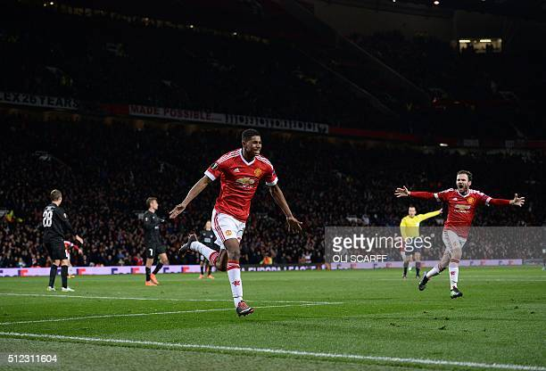 Manchester United's English striker Marcus Rashford celebrates scoring his team's third goal during the UEFA Europa League round of 32 second leg...
