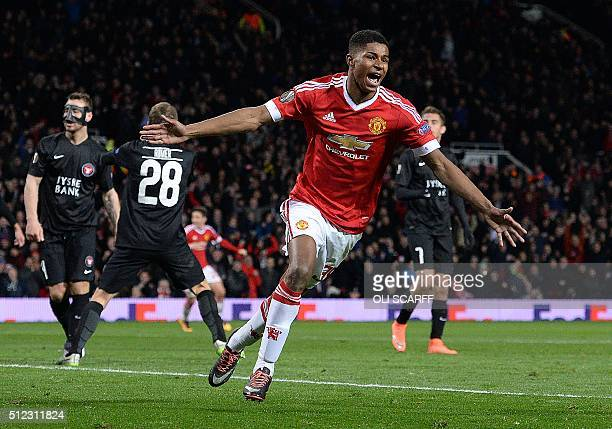 TOPSHOT Manchester United's English striker Marcus Rashford celebrates scoring his team's third goal during the UEFA Europa League round of 32 second...
