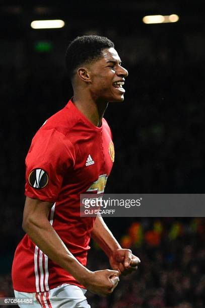 Manchester United's English striker Marcus Rashford celebrates scoring their second goal during the UEFA Europa League quarterfinal second leg...