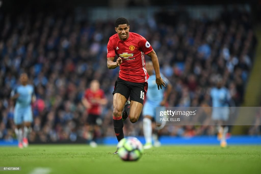 Manchester United's English striker Marcus Rashford chases the ball during the English Premier League football match between Manchester City and Manchester United at the Etihad Stadium in Manchester, north west England, on April 27, 2017. / AFP PHOTO / Paul ELLIS / RESTRICTED TO EDITORIAL USE. No use with unauthorized audio, video, data, fixture lists, club/league logos or 'live' services. Online in-match use limited to 75 images, no video emulation. No use in betting, games or single club/league/player publications. /