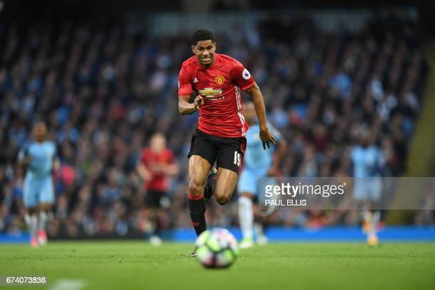 Manchester United's English striker Marcus Rashford chases the ball during the English Premier League football match between Manchester City and...