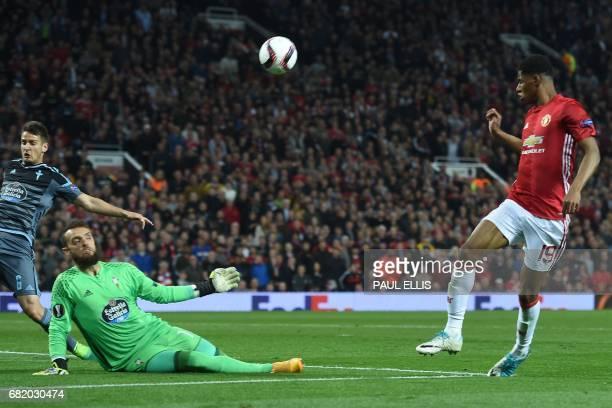 Manchester United's English striker Marcus Rashford has this attempt saved by Celta Vigo's Spanish goalkeeper Sergio Alvarez during the UEFA Europa...