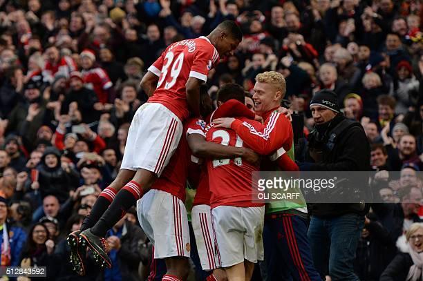 Manchester United's English striker Marcus Rashford joins the celebration after Manchester United's Spanish midfielder Ander Herrera scored their...