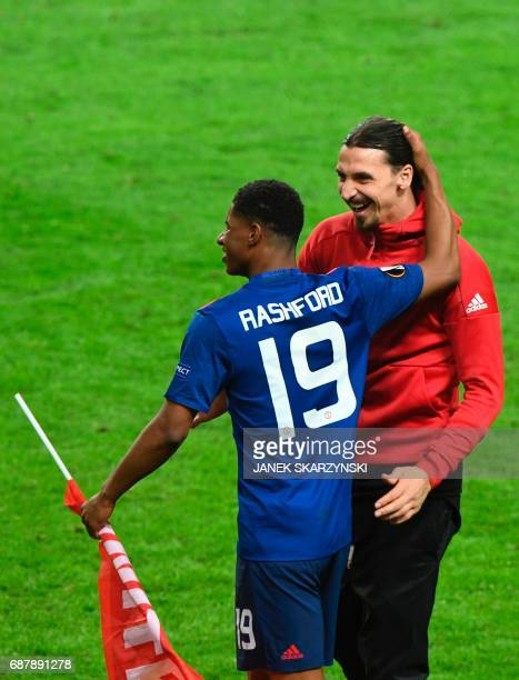 Manchester United's English striker Marcus Rashford Manchester United's Swedish injured striker Zlatan Ibrahimovic after the UEFA Europa League final...