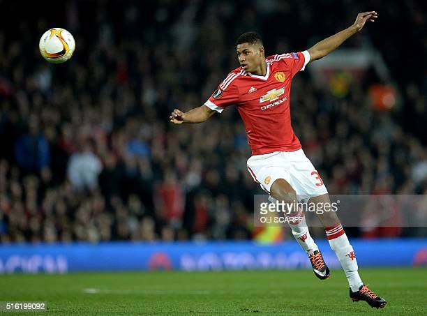Manchester United's English striker Marcus Rashford passes the ball during the UEFA Europa League round of 16 second leg football match between...