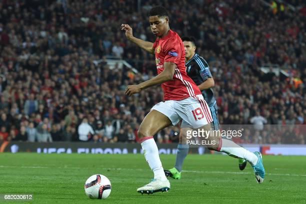 Manchester United's English striker Marcus Rashford runs in on goal during the UEFA Europa League semifinal secondleg football match between...