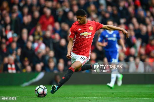 Manchester United's English striker Marcus Rashford shoots but misses the target during the English Premier League football match between Manchester...