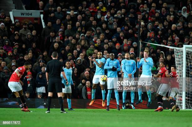 Manchester United's English striker Marcus Rashford takes a free kick during the English Premier League football match between Manchester United and...