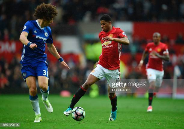 Manchester United's English striker Marcus Rashford takes on Chelsea's Brazilian defender David Luiz during the English Premier League football match...