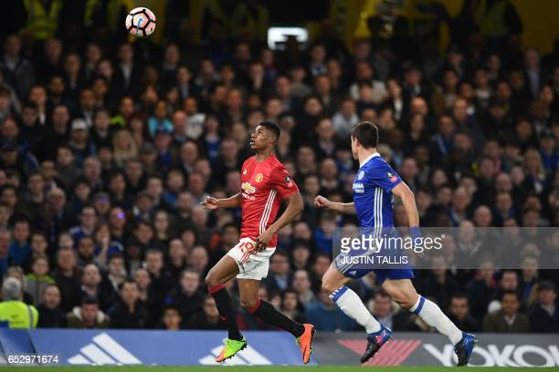 Manchester United's English striker Marcus Rashford vies with Chelsea's Spanish defender Cesar Azpilicueta during the English FA Cup quarter final...