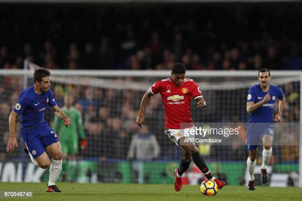 Manchester United's English striker Marcus Rashford vies with Chelsea's Spanish defender Cesar Azpilicueta during the English Premier League football...