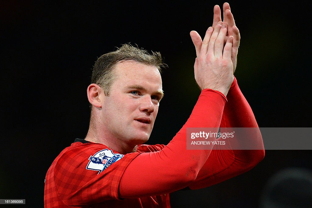 "Manchester United's English striker Wayne Rooney acknowledges the crowd after the final whistle in the English Premier League football match between Manchester United and Everton at Old Trafford, Manchester, North West England, on February 10, 2013. Manchester United won the match 2-0 to secure a 12 point lead at the top of the Premier League table. USE. No use with unauthorized audio, video, data, fixture lists, club/league logos or ""live"" services. Online in-match use limited to 45 images, no video emulation. No use in betting, games or single club/league/player publications."