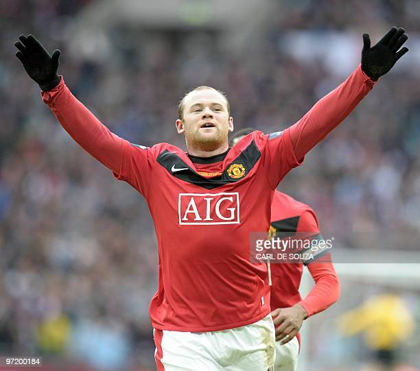 Manchester United's English striker Wayne Rooney celebrates after scoring his team's second goal against Aston Villa during the 2010 Carling Cup...