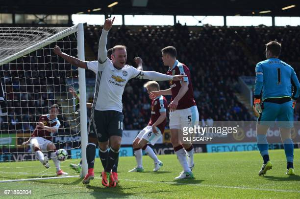 Manchester United's English striker Wayne Rooney celebrates after scoring during the English Premier League football match between Burnley and...