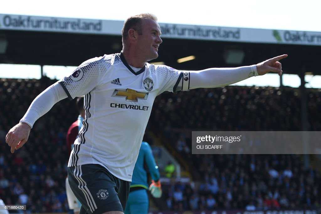 Manchester United's English striker Wayne Rooney celebrates after scoring during the English Premier League football match between Burnley and Manchester United at Turf Moor in Burnley, north west England on April 23, 2017. / AFP PHOTO / Oli SCARFF / RESTRICTED TO EDITORIAL USE. No use with unauthorized audio, video, data, fixture lists, club/league logos or 'live' services. Online in-match use limited to 75 images, no video emulation. No use in betting, games or single club/league/player publications. /
