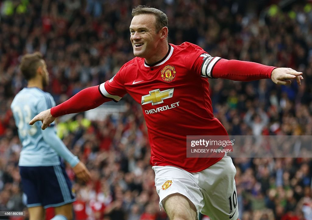 Manchester United's English striker Wayne Rooney celebrates scoring the opening goal during the English Premier League football match between...