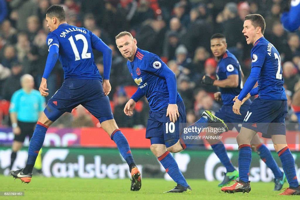 Manchester United's English striker Wayne Rooney (C) celebrates scoring his 250th goal to make him the club's all-time record goal scorerer in the English Premier League football match between Stoke City and Manchester United at the Bet365 Stadium in Stoke-on-Trent, central England on January 21, 2017. / AFP / Lindsey PARNABY / RESTRICTED TO EDITORIAL USE. No use with unauthorized audio, video, data, fixture lists, club/league logos or 'live' services. Online in-match use limited to 75 images, no video emulation. No use in betting, games or single club/league/player publications. /