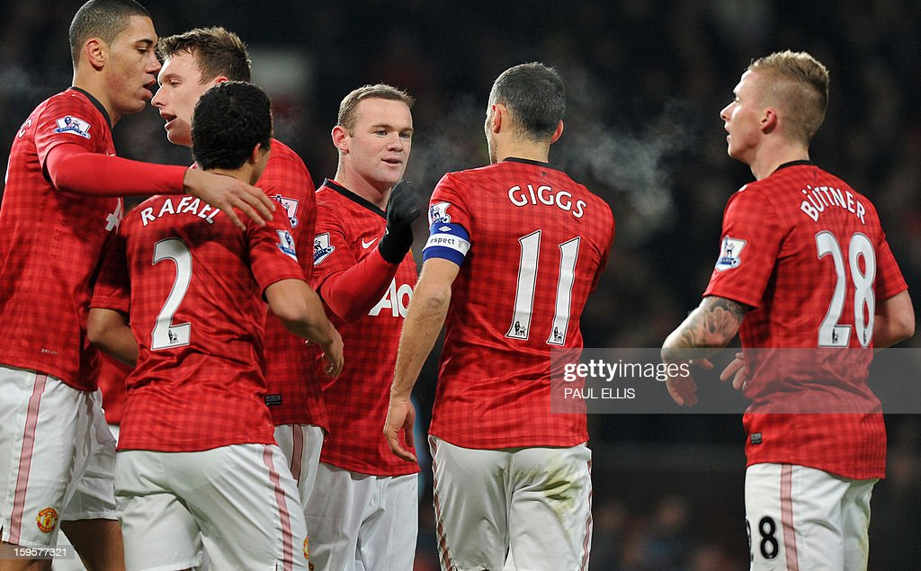 "Manchester United's English striker Wayne Rooney (3rd R) celebrates with captain, Welsh midfielder Ryan Giggs (2nd R) after scoring the opening goal of the English FA Cup third round replay football match between Manchester United and West Ham United at Old Trafford, Manchester, North West England on January 16, 2013. USE. No use with unauthorized audio, video, data, fixture lists, club/league logos or ""live"" services. Online in-match use limited to 45 images, no video emulation. No use in betting, games or single club/league/player publications."